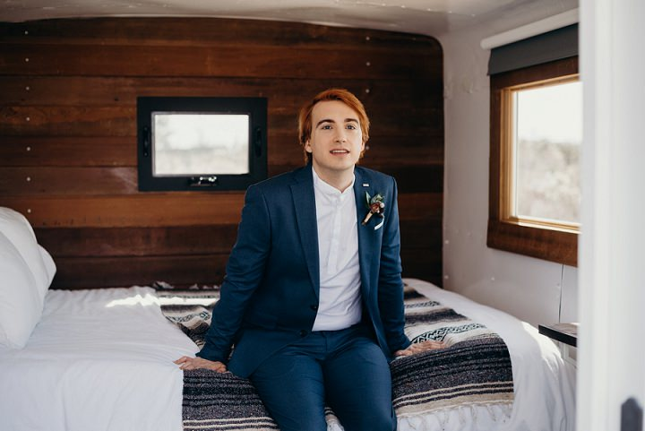 One groom chose a navy suit and a white shirt for the ceremony