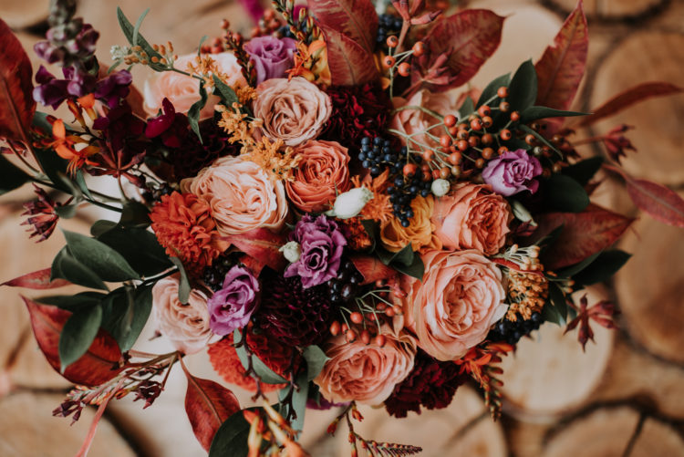 The bride made up her bouquet herself using blooms of fall colors and greenery
