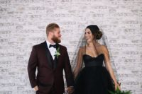03 a burgundy suit with black lapels for the groom and a black wedding dress for the bride