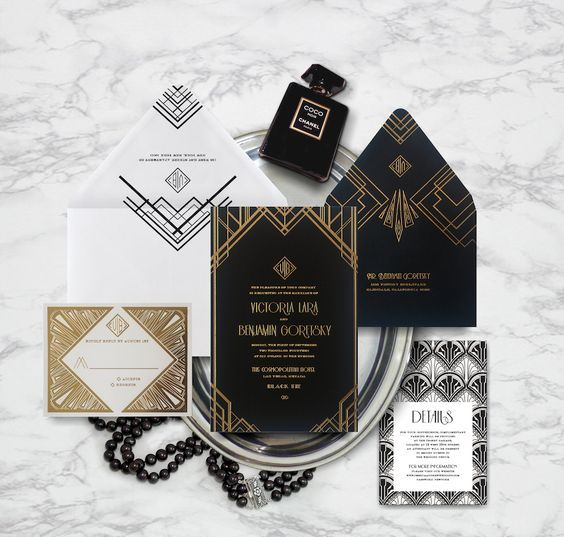 a chic art deco wedding invitation suite in black, white and with gold foil