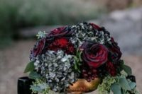 03 blood-red roses, black hydrangeas, seeded eucalyptus in a gold bowl for bold and dramatic look