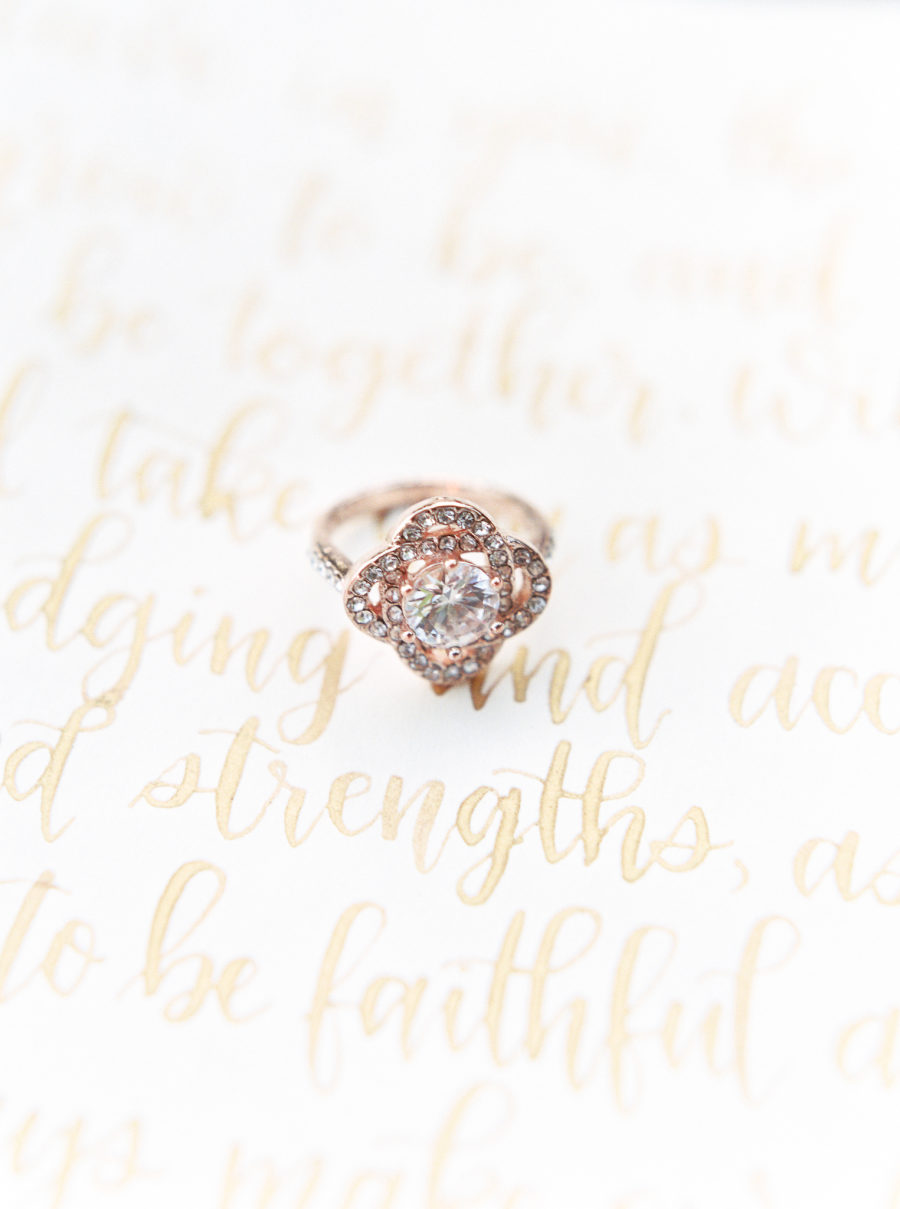 The beautiful romantic rose gold ring with rhinestones added to the bridal look