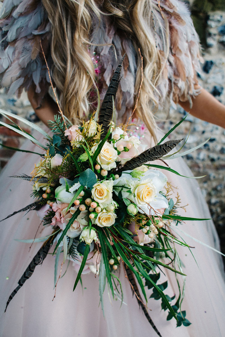 The bouquet was a creative and textural piece with much foliage and feathers