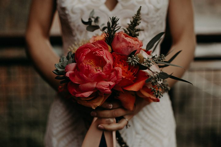 The bridal bouquet was of pink peonies, succulents, herbs and greenery