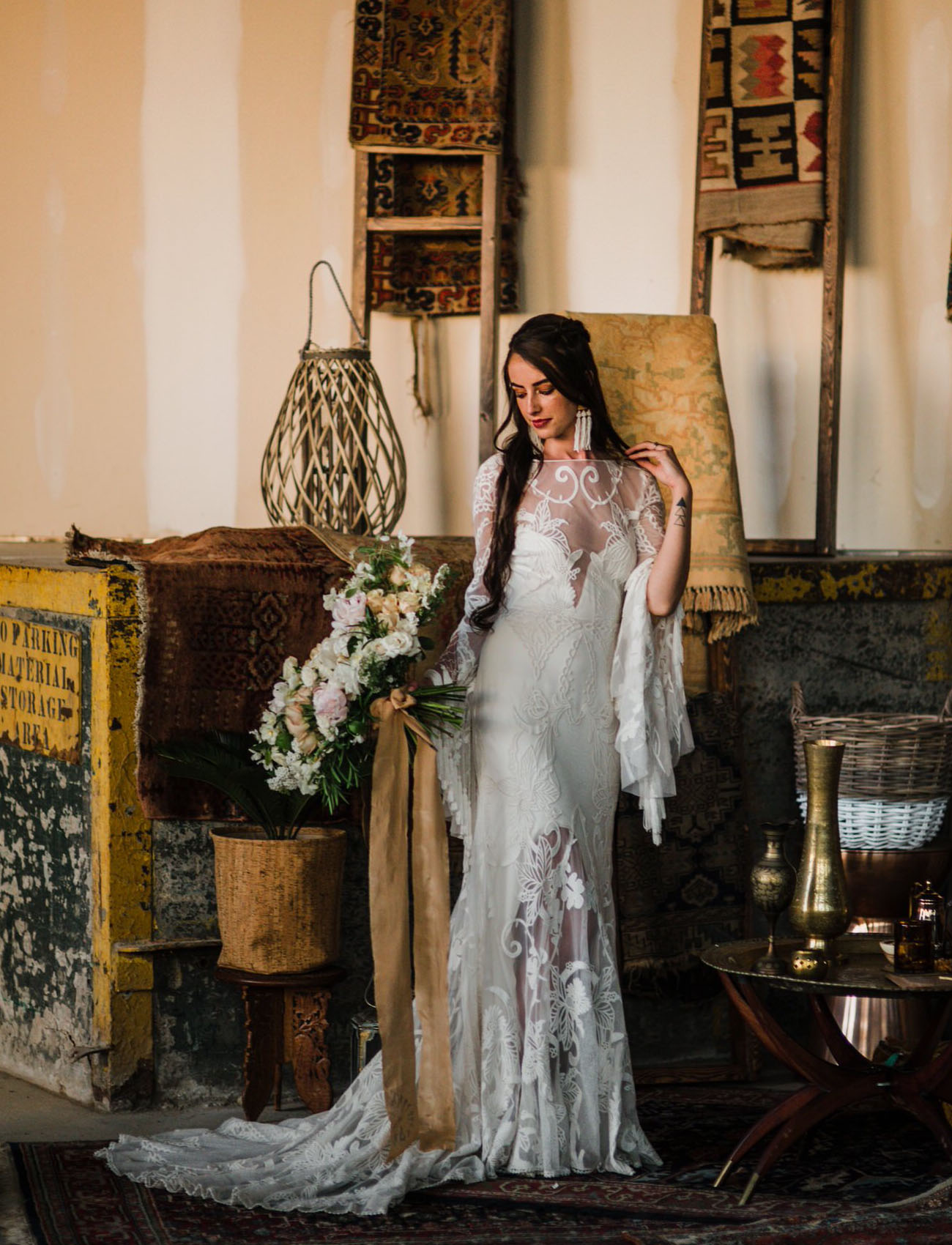 The bride was wearing a fantastic Rue De Seine wedding dress with a lace overlay and bell sleeves