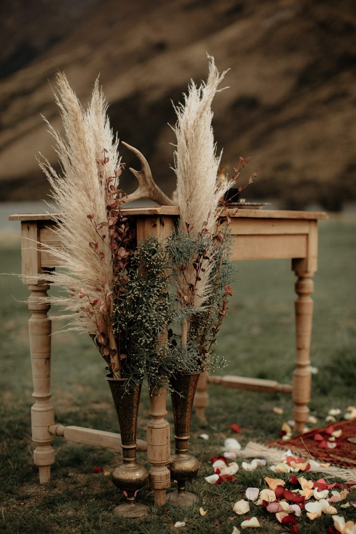 The wedding altar was done of a wooden table, dried flowers and herbs, antlers and Persian rugs