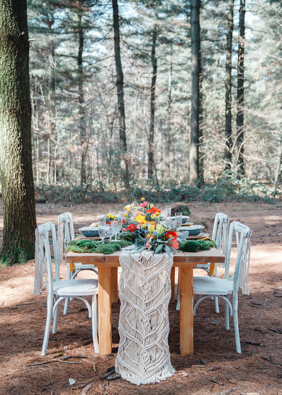 The wedding tablescape was done with a moss and macrame table runner