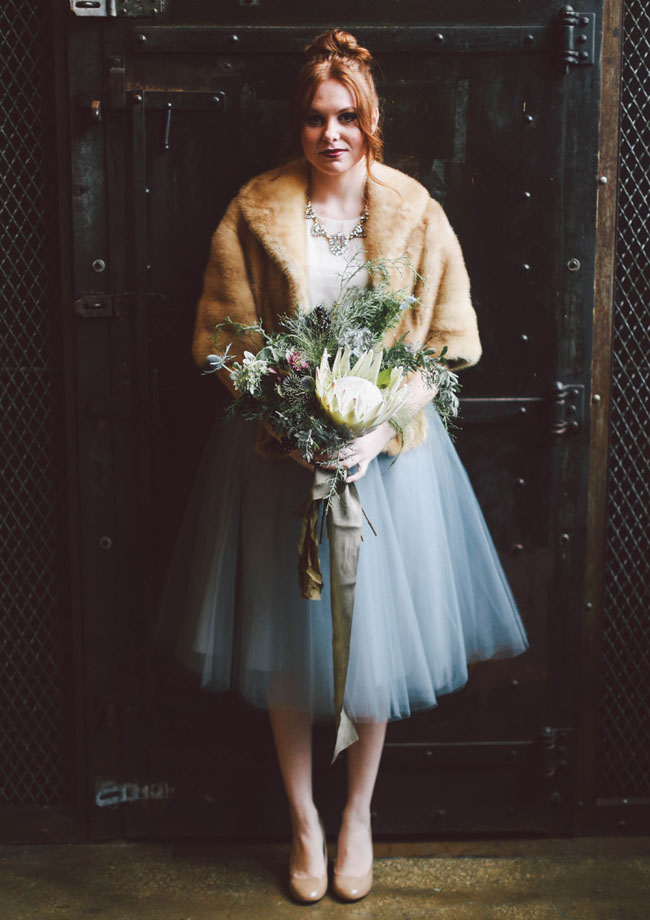 a chic bridal separate with a creamy top and a blue tulle midi skirt, a faux fur coverup