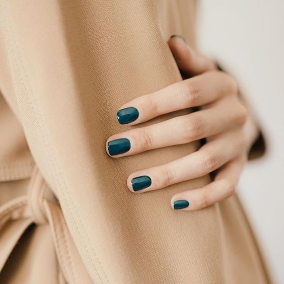 teal nails are another cool fall idea, non-traditional as it's not emerald, and bold and fall-like