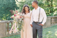 05 The bride was wearing a blush wedding dress with a deep V-neckline and a delicate hair vine