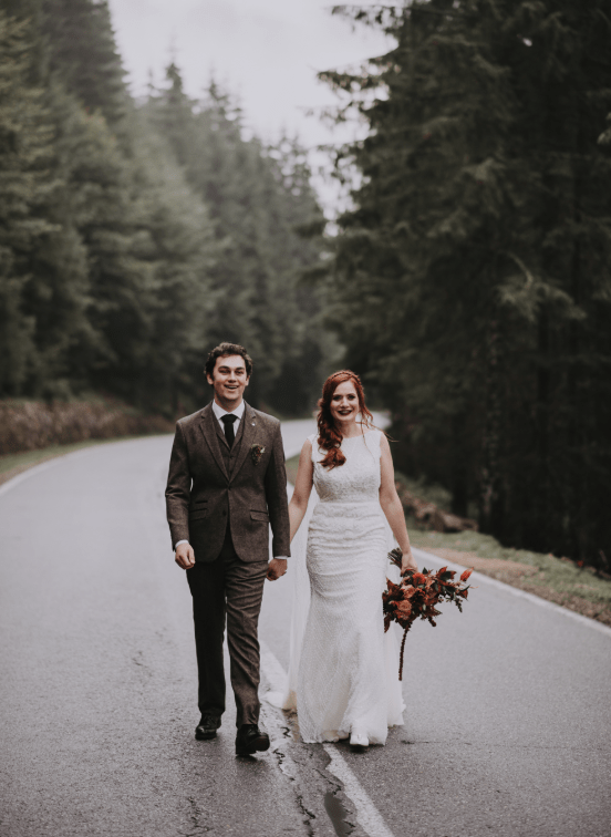 The bride was wearing a lace sheath embellished wedding dress with no sleeves and a high neckline, the groom was wearing a three-piece tweed suit
