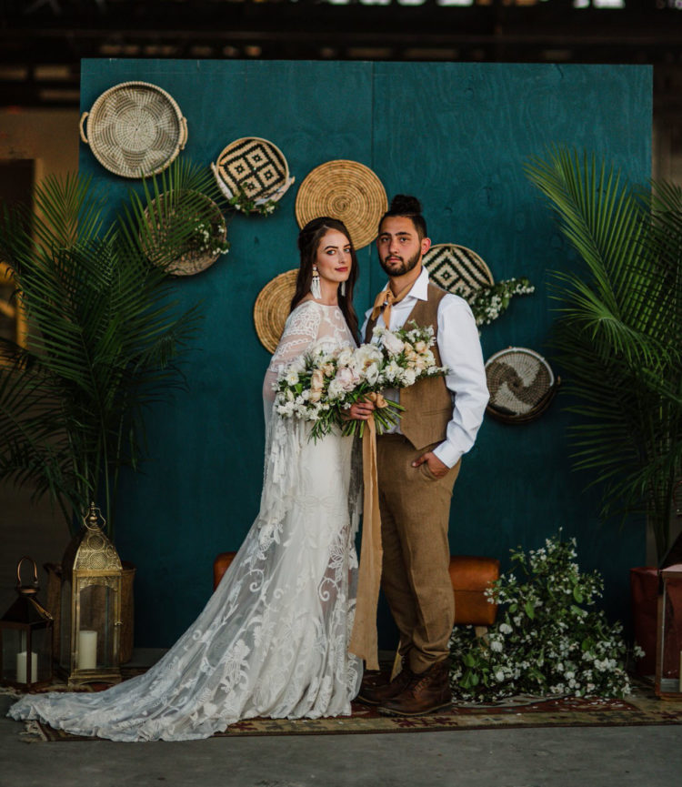 The groom was wearing a three-piece earthy suit, brown combat boots and a top knot