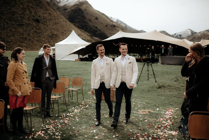 The grooms were wearing creamy jackets and waistcoats, white shirts, black pants and shoes