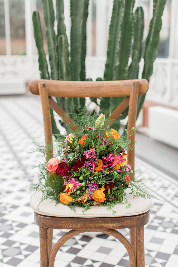 The wedding bouquet was a bright one, with orange, red and pink touches