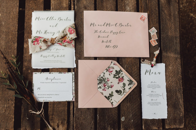 The wedding invitation suite was done in soft pink and with florals and stamps