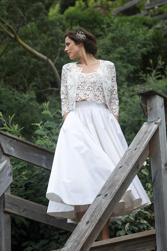 a chic bridal separate with a crochet lace top and bolero and a full plain skirt