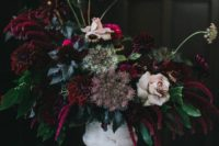 05 a vintage whitewashed vase with deep purple and burgundy blooms, pale rosesm herbs and greenery