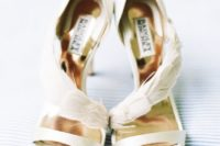 05 beautiful ethereal creamy wedding shoes with a feathered detail