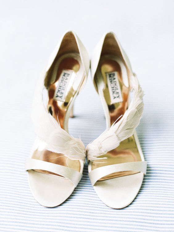 beautiful ethereal creamy wedding shoes with a feathered detail