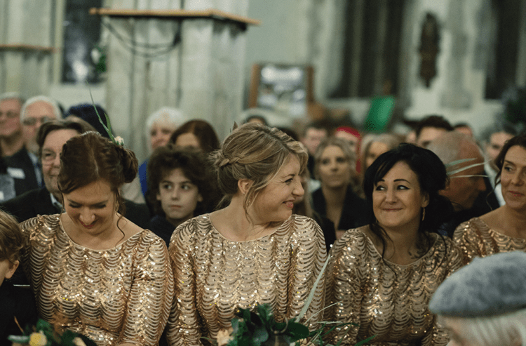 The bridesmaids were wearing gold sequin gowns and rocking updos