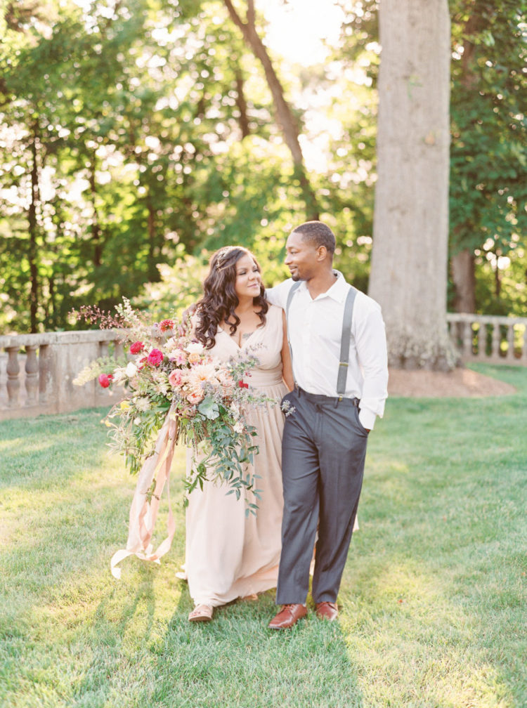 The groom was rocking a vintage look with a white shirt, grey pants and suspenders plus maroon shoes