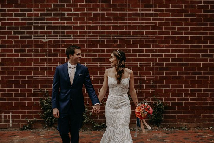 The groom was wearing a navy suit with a blush polka dot tie