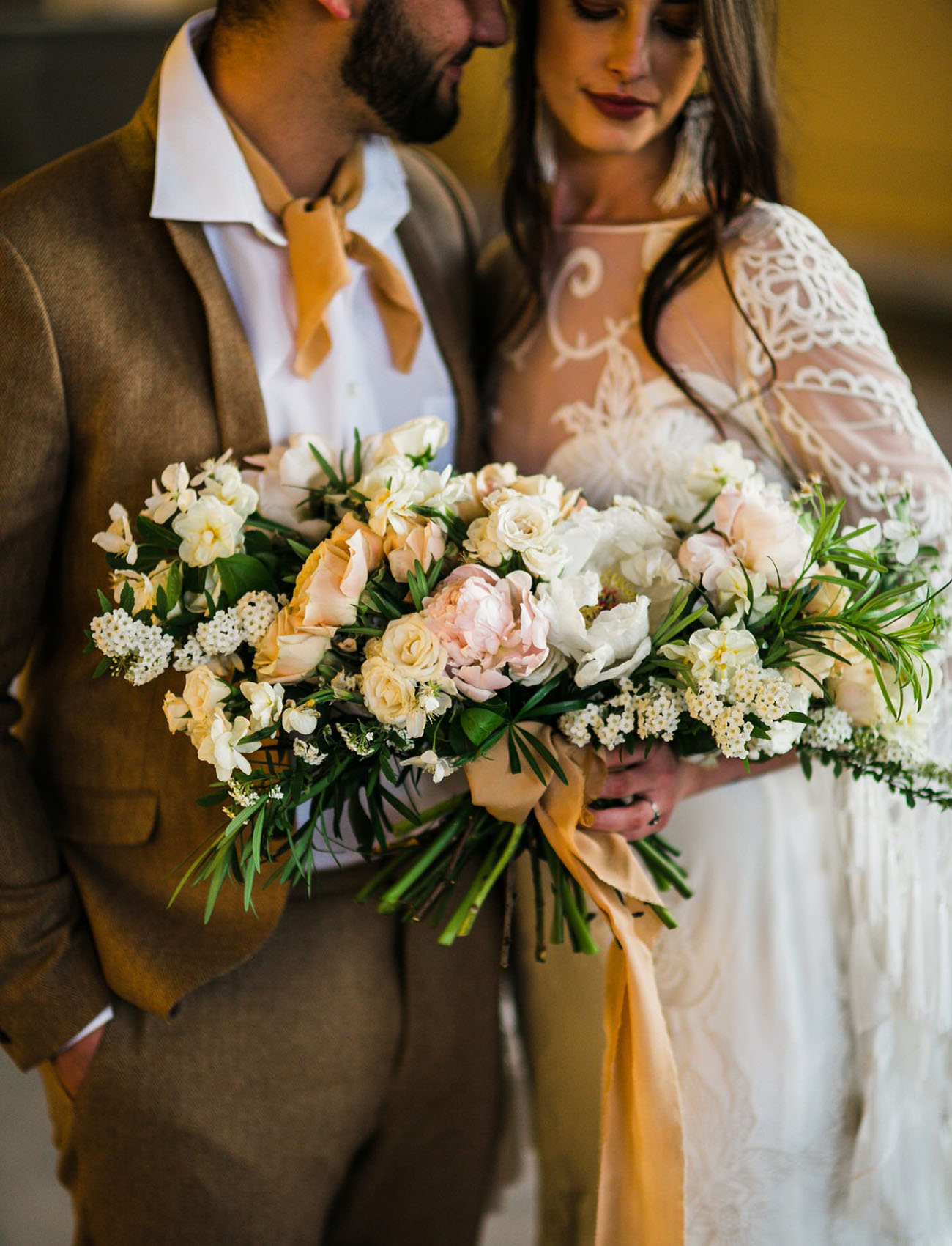 The wedding bouquet was lush and neutral, with blush and white blooms