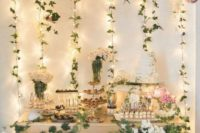 06 a lush spring garden dessert table with lights and hanging greenery and blooms in pink and white