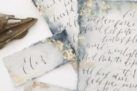 06 chic wedding stationery in grey and white with gold flecks on the corners