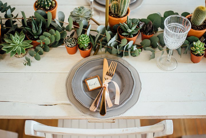 Eucalyptus added freshness and the plates and chargers were grey ones for a more peaceful look