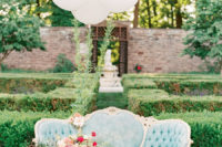07 The beautiful garden was spruced up with a refined blue sofa and white baloons