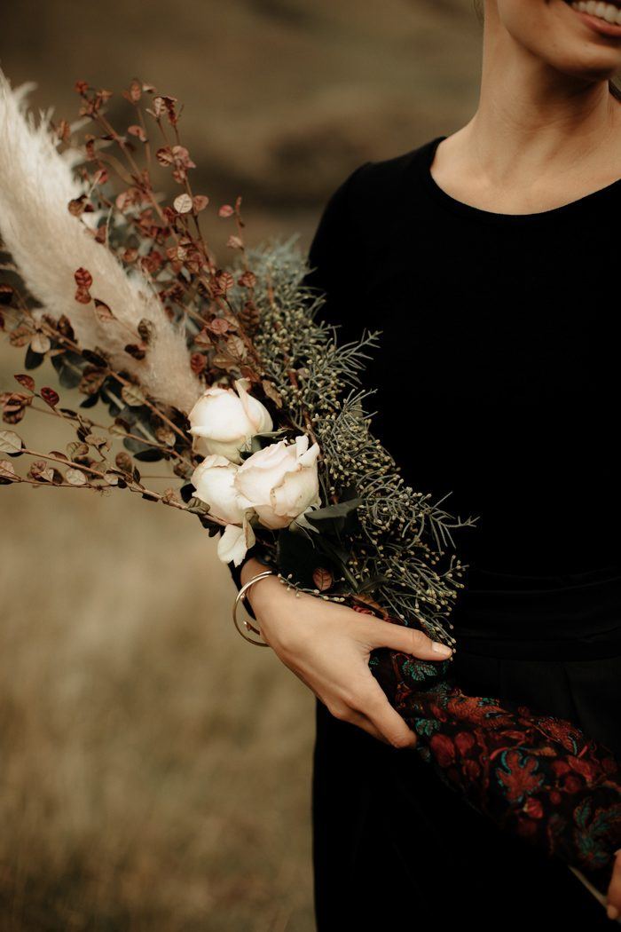 The bridesmaids' bouquets were done of dried herbs and blooms for a moody look