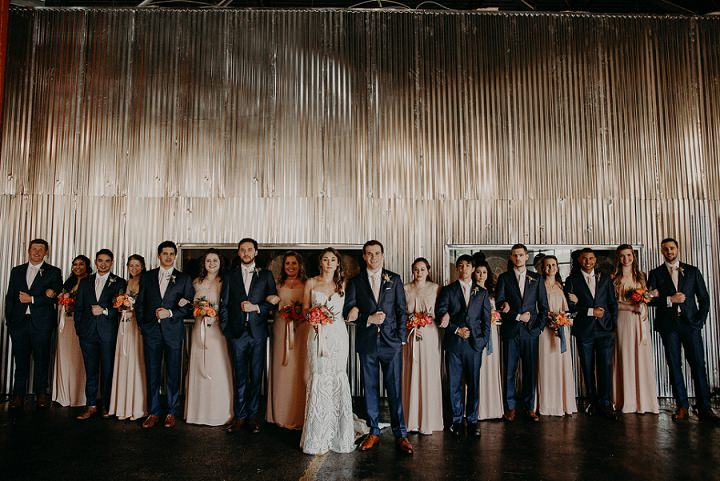 The bridesmaids were wearing peachy strapless maxi gowns and the groomsmen were dressed like the groom