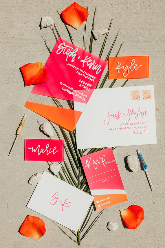 The wedding invitation suite was done in orange and pink, all modern to match the shoot