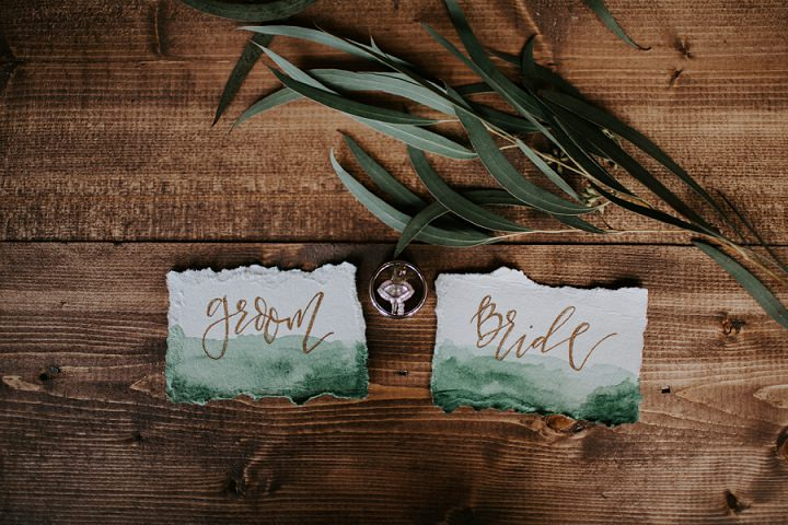 The wedding stationery was watercolor green with raw edges