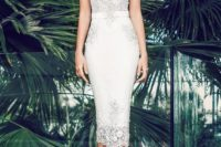 07 a chic lace embellished sheath wedding dress with cap sleeves and an embellished sash for a modern romantic bride