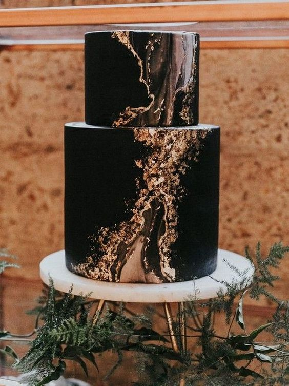 a chic modern black wedidng cake with touches of gold is a great idea for a modern Halloween wedding