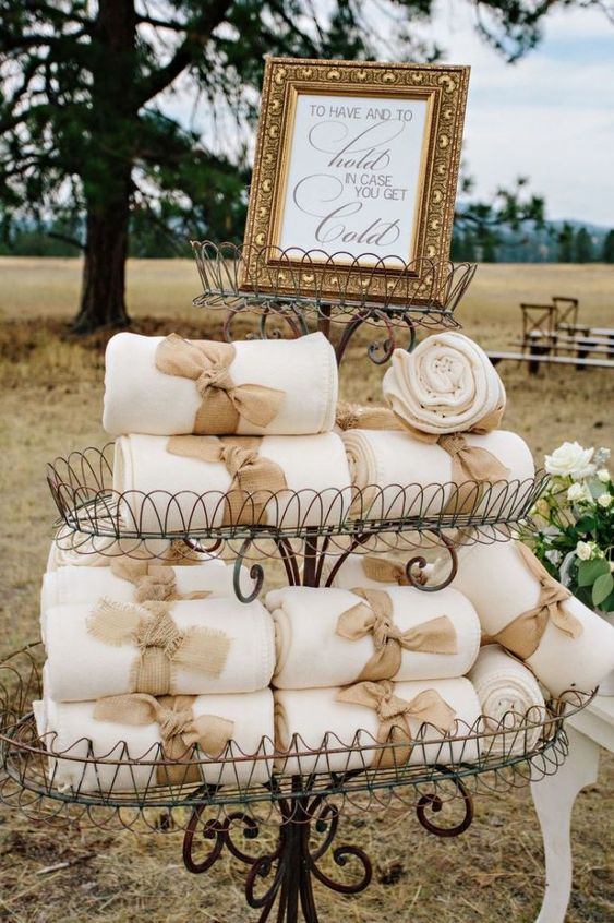 some comfy blankets with burlap ties for a rustic mountain wedding will save your guests from cold