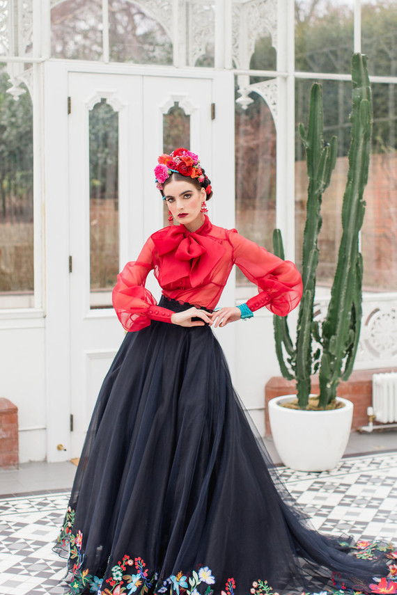 One more look was with a bold red blouse and a black skirt with some embroidered florals