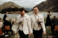 08 The grooms rocked feather necklaces after the ceremony for fun