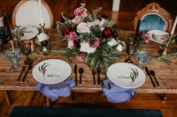 08 The wedding tablescape was done with the same lush florals, candles, colored napkins and glasses