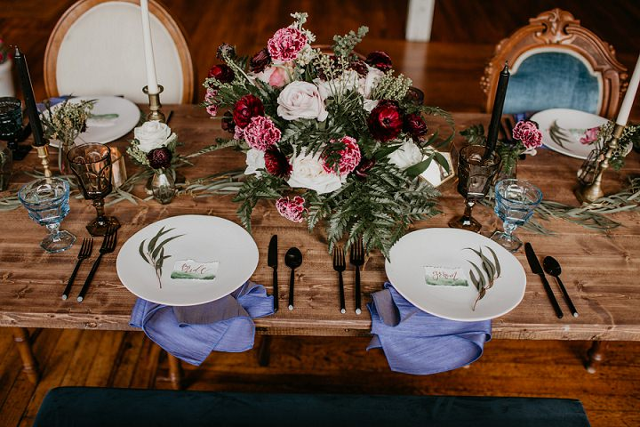 The wedding tablescape was done with the same lush florals, candles, colored napkins and glasses