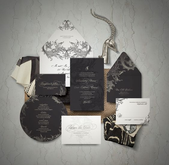 a black and white wedding invitation suite with calligraphy and refined prints for a chic look