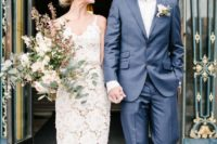 08 a floral lace sheath wedding dress on spaghetti straps, nude pumps and statement earrings