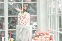 08 a modern geometric dessert table with copper and marble touches and faceted items
