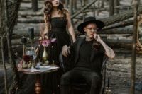 08 an offbeat look with a black tee, waistcoat, pants and boots plus a hat for a modern witch wedding