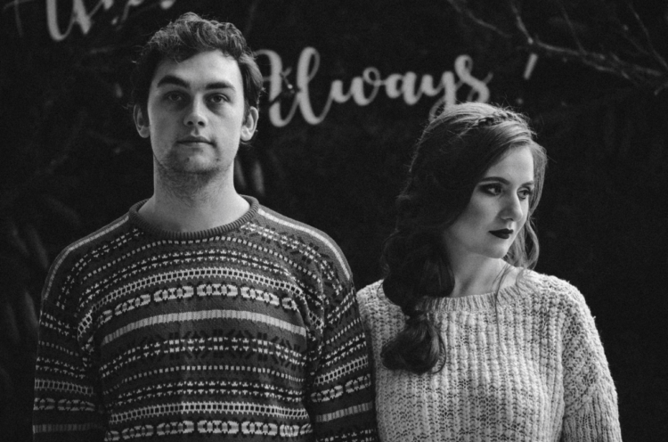 The bride and the groom put on sweaters for more comfort