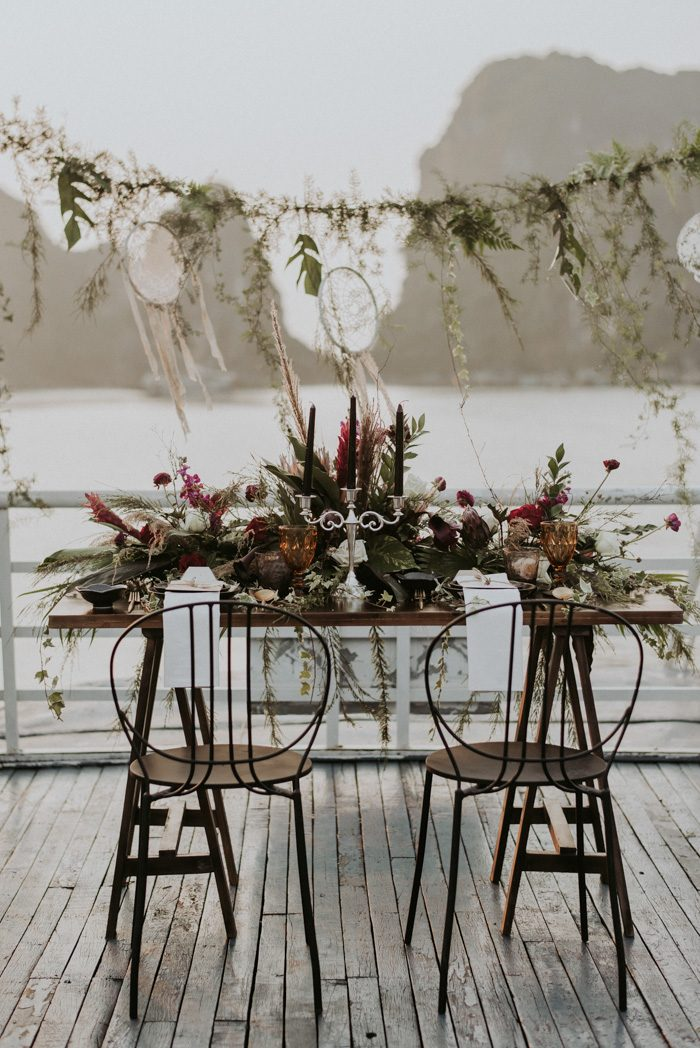 The space was decorated with greenery, dream catchers, blooms and textural grasses plus candles