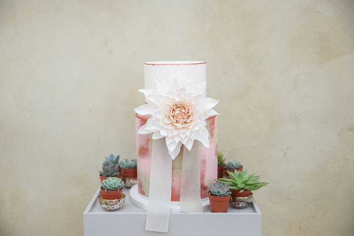 The wedding cake was a pink brushstroke one with an oversized flower and ribbons