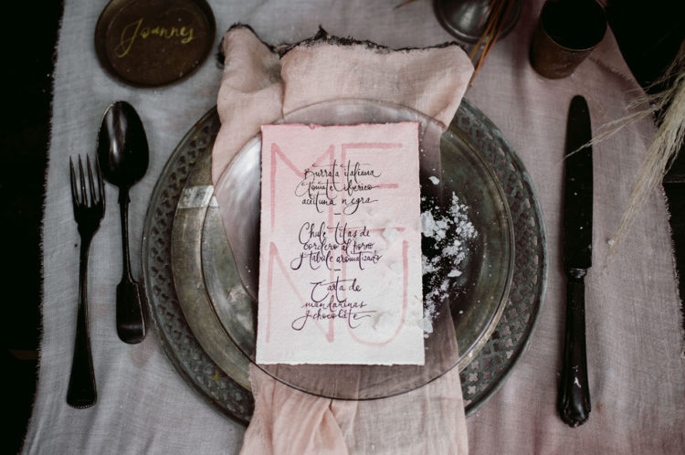 Vintage plates and cutlery, pink menus and some salt on the plates created a mood